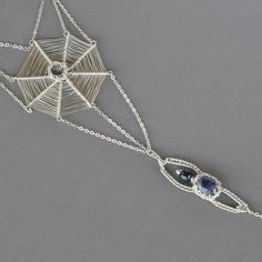 The necklace which tells a story is up in the shop.