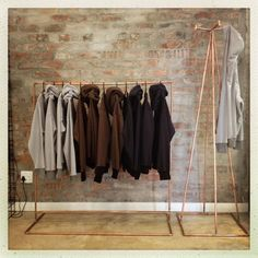 Wall in background - exposed facebrick. also - Originally created as shop fittings, these copper clothing rails by Cape Town-based designer, Lasith Madurasinghe, add a beautiful industrial accent to a room.
