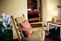 self-catering barn sleeping 4 overlooking the Black Mountains, set in 48 acres of hillside and woodland, Garn Farm provides the perfect escape. Rocking Chair, Cosy, Duvet, Accent Chairs, Barn, Bedroom, Furniture, Home Decor, Chair Swing