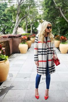 Atlantic-Pacific wearing a checked wool coat and bold red accessories