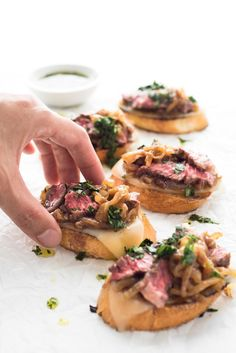 Prepare your taste buds! Tender, juicy steak on crusty garlic bread, with aged provolone cheese, rich caramelized onions, and a drizzle of parsley oil.