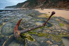 Wreck Beach, Australia  One of the anchors from the Marie Gabrielle, wrecked here in 1869.   The ship was on route from China with a load of tea when it hit the reef after being forced ashore by strong winds. (photo by Nelson Chenkin)