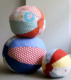 Fun with little bells inside...maybe ribbons looped in the seams to make it like a taggie ball for little ones.   DIY: fabric beach balls