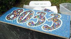 DIY Mosaic House Numbers - I have done this when we used to go to pottery classes. It is actally fun and easy - especially if you are using broken up dishes and tiles that you aren't making yourself.