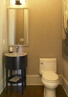 Basement suite: Small bathrooms call for small fixtures, and the petite vanity provides drawers and shelves for a space that lacks storage. Kohler Bathroom, Bathroom Fixtures, Kohler Vanity, Tiny Powder Rooms, Small Toilet, Bathroom Styling, Bath Remodel, Basement Remodeling, Bathroom Furniture