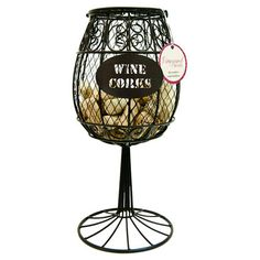 Open metalwork wine cork holder with a stemware-inspired shape.  Product: Cork holderConstruction Material: Meta...
