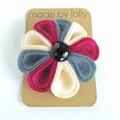 The Harlequin Felt Corsage in Hot Pink, Cream and Grey. Felt Flower Brooch handmade in the UK by Laura Smith of made by lolly. Available from Etsy +£10.00
