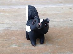 Skunk: Handmade miniature polymer clay animal by AnimalitoClay