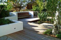 white courtyard walls and timber decking and seating