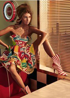 Stella Maxwell wears printed Moschino dress