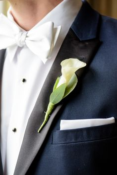 Love the simplicity and classic white bow tie! View the full wedding here: http://thedailywedding.com/2015/12/09/classic-pennsylvania-wedding-diana-cristian/