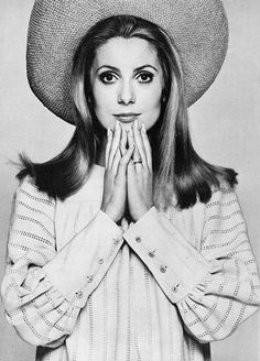 """Catherine Deneuve is wearing a """"Gigi"""" smock of light biscuit Irish linen lined with open work by Mary Quant, photo by David Bailey for Vogue, 1967"""