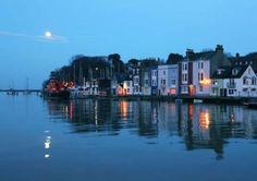 Moonlight Over Weymouth Harbour in Dorset, England, situated on a sheltered bay at the mouth of the River Wey on the English Channel coast.  The history of the borough stretches back to the 12th century; including involvement in the spread of the Black Death, the settlement of the Americas, the development of Georgian architecture, and preparations for World War II.  You can read more on Wikipedia, here:  http://en.wikipedia.org/wiki/Weymouth_Harbour,_Dorset