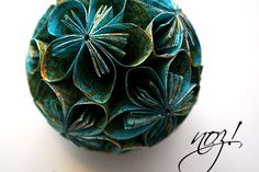 #Recycling - Flower balls made of painted and stamped old book pages.    The tutorial you will find here:  http://nozdesign.blogspot.com/2011/02/damit-der-fruhling-endlich-kommt.html