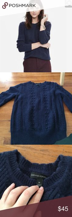Banana Republic/ navy Pom Pom cable sweater Current season.Super cute and soft.              42% nylon, 30% merino wool, 28% alpaca hair. Machine wash. Imported.  PRODUCT DETAILS Scallop Crew neck. Long sleeves. Rib-knit trim. #305708 Banana Republic Sweaters Crew & Scoop Necks