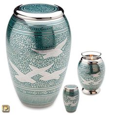 Returning Home Brass Cremation Urn with Doves - Urns Northwest. White doves are engraved over a hand-etched swirl design, inlaid with blue enamel in an elegant pattern.
