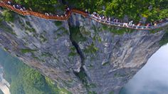 Check it out! China's new tourist attraction now offers something for those looking to get the heart racing, the vertigo-inducing Coiling Dragon Cliff skywalk.  The breathtaking new skywalk gives tourists a palm sweating view like no other.
