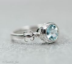 Sterling Silver or 14k White Gold Genuine Round Aquamarine & .02 CTW Diamond Ring by SparkleNJade on Etsy https://www.etsy.com/listing/232004090/sterling-silver-or-14k-white-gold