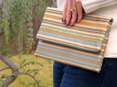 Made from a high-end repurposed curtain in a soft blue, gold and tan with a light sheen. Winter Blue Clutch by UnshatteredNY on Etsy - Bags from repurposed materials made by women rebuilding their lives that have been shattered by addiction. Check them out at Unshattered.org