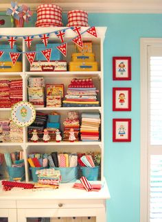 Every. Single. Thing. in this picture makes me want to squeel. Turquoise and red, bunting, checkers, vintage pictures, buckets, polka dot fabric, small suitcases, and more.