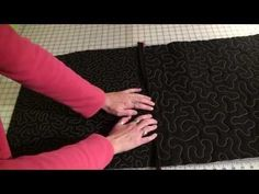 Video Tutorial for connecting already quilted blocks.This is a brilliant tutorial....she shows how to machine or hand stitch the blocks together..I wish she had used another colour than black for all the blocks and sashing though. !,