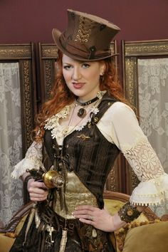 Steampunk/Victorian merge of fashion with the classic lace up embellished top hat to the corset ivory crocheted sleeve detail flowing down to her hands armed with a metal blaster. Mode Steampunk, Steampunk Couture, Steampunk Cosplay, Steampunk Design, Victorian Steampunk, Steampunk Clothing, Steampunk Fashion, Gothic Fashion, Steampunk Makeup