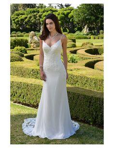 Light, destination gown available at Spotlight Formal Wear! #SpotlightBridal