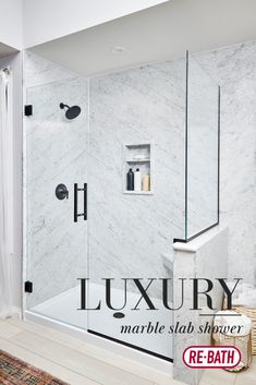 This Re-Bath walk-in shower is made from solid slab Carrara marble. It features frameless glass shower doors and matte black accessories, and a low-profile shower base. Upgraded to inset shower storage to maintain a modern design. Shower Base, Walk In Shower, Stone Shower, Shower Storage, Complete Bathrooms, Glass Shower Doors, Carrara Marble, Bath Remodel, Faucets
