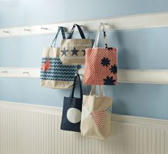 Create one-of-a-kind tote bags with graphic stencils and multi-surface craft paint.