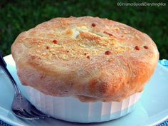 PIZZA POT PIES - Two classics come together to make these hearty and delicious pizza pot pies.  They are covered in a crispy, golden crust made of pizza dough brushed with olive oil and sprinkled with Parmesan cheese. Tucked inside are some of my favorite pizza toppings, Italian sausage, black olives, onions, in a tomato sauce and plenty of mozzarella cheese.