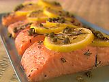 Classic year-round dish: salmon with lemon, capers, and rosemary baked in aluminum foil - no cleanup!