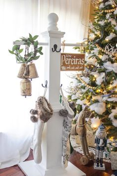 DIY Stocking post with family name sign. Perfect for an entry or front porch or if you don't have a mantel.