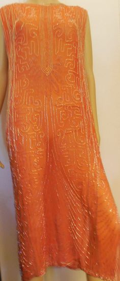 1920'S ORANGE SILK FRENCH CHANTEUSE BEADED FLAPPER DRESS. It is sheer silk with thousands of hand sewn bugle beads in an intricate pattern. Made in France, maker is unknown. Front