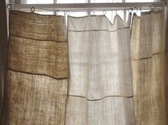 I've used antique French  hand towels in my kitchen to make little cafe curtains ~