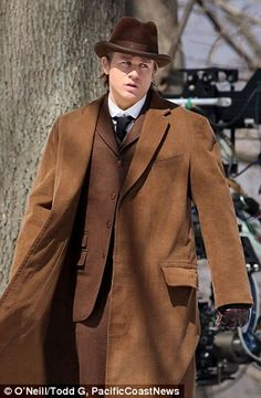 Double take: Sons of Anarchy's Charlie Hunnam looked every bit the dapper Englishman suited up on the Ontario set of his new film Crimson Peak Thursday