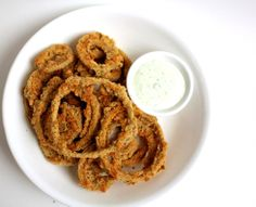 baked onion rings with basil cream sauce.