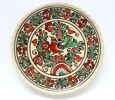 his is a decorative handcrafted ceramic plate from Corund (Korond), elaborately ornamented with raised painting. The diameter is about cm in). You can buy this hand made ceramic plate on our Bonanza webstore. Ceramic Plates, Ceramic Pottery, Turism Romania, Vintage Beauty, Rustic Decor, Vintage Shops, Folk Art, Hand Painted, Traditional