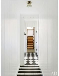 Inspired Hallway Designs That are Far From Boring Amelia T. Handegan designed the painted floors of the hallway in her Folly Beach, South Carolina, home. The stripes chan. House Styles, Flooring, Beach Bungalows, House, Bungalow, White Floors, Floor Design, Hallway Designs, Architectural Digest