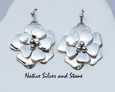Navajo jewelry artist Artie Yellowhorse created this unique multi-layered design of a dogwood flower. Handmade from silver. Shown in french wire, also available in post. From Native Silver Silver and Stone