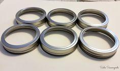 Mason Jar lid rings to be repurposed into Christmas ornaments wreath / www.sadieseasongoods.com