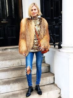 Pandora Sykes wears a gold sequin turtleneck, faux fur coat, ripped-knee jeans, and black ankle boots