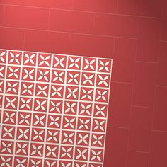 Harvey Maria Little Bricks luxury vinyl tiles in Venetian Red in a basket pattern creating a border around Dee Hardwicke Lattice Cherry Red petal design floor.