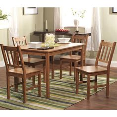 Choosing an ecofriendly five-piece dining set is a great way to protect the earth while giving your home a unique style. This set includes the table and four chairs with durable construction to withstand heavy use from your family and guests.