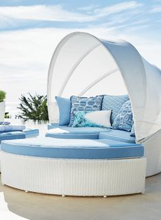 With 231 cu. ft. of space, our versatile, all-weather Baleares Daybed serves as a private lounger or seating for six. The handsome white wicker imparts a breezy, tropical feel and new designer cushions enliven the look with pattern and dimension. For privacy, simply push the four pieces together and extend the canopy.