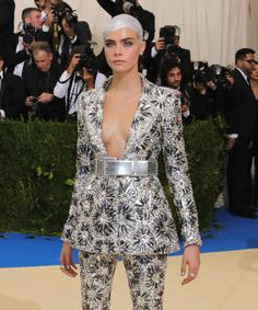 Cara Delevingne Bedazzled Her Head & Boobs For The Met Gala — & It's So Extra+#refinery29