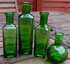 FOUR ANTIQUE VICTORIAN/EDWARDIAN 1890/1910 GREEN GLASS LADIES PERFUME BOTTLES