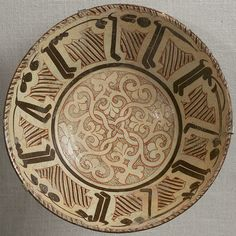 Bowl with Arabic inscription, late 10th–11th century.  Found at Iran, Nishapur, Tepe Madrasa Earthenware; white slip with polychrome slip decoration under transparent glaze | The Metropolitan Museum of Art