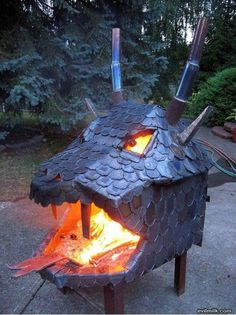 A fire pit that looks like a fire creating dragon. Nice blacksmithing work.