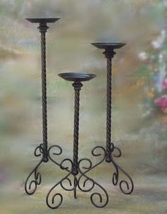 Wrought iron candle stands for country charm to warm up contemporary furniture.