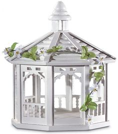 White Gazebo Bird Feeder. Our platform bird feeder is artistically decorated with gingerbread moldings and some greenery. A lovely place to watch birds to come in and eat! Wood and plastic.